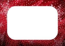 Marco blanco rojo de la Navidad de los copos de nieve Imágenes de archivo libres de regalías