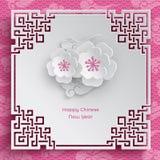 Marco chino del modelo con dos flores Imágenes de archivo libres de regalías