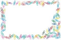 Marco colorido de clips de papel estorbados foto de archivo libre de regalías