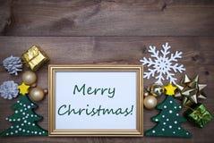 Marco con Feliz Navidad de la decoración y del texto Imagenes de archivo