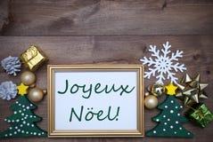 Marco con la decoración, Joyeux Noel Mean Merry Christmas Imagenes de archivo
