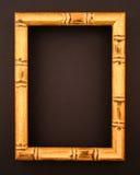 Marco de bambú en superficie negra Fotos de archivo libres de regalías