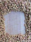 Marco de la alholva en fondo de madera Imagen de archivo