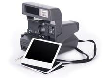 Marco de la cámara polaroid y de la foto Fotos de archivo libres de regalías