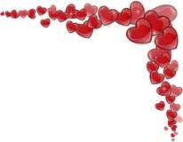 Marco de la esquina de corazones rojos en un fondo blanco por un día de tarjeta del día de San Valentín Foto de archivo