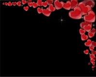 Marco de la esquina de corazones rojos en un fondo negro por un día de tarjeta del día de San Valentín Imagen de archivo