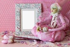 Marco de la foto con la hada en rosa Fotografía de archivo libre de regalías
