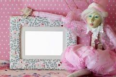 Marco de la foto con la hada en rosa Imagen de archivo libre de regalías