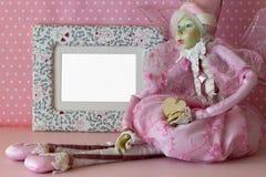 Marco de la foto con la hada en rosa Fotos de archivo libres de regalías