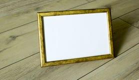 Marco de la foto del oro Imágenes de archivo libres de regalías