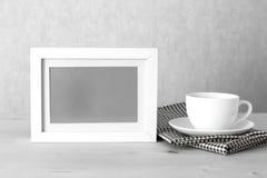 Marco de la foto y taza de café Imágenes de archivo libres de regalías