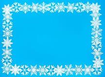 Marco de la frontera y del fondo del copo de nieve Fotografía de archivo
