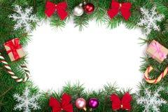Marco de la Navidad adornado con los copos de nieve aislados en el fondo blanco con el espacio de la copia para su texto Visión s Foto de archivo