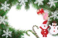 Marco de la Navidad adornado con los copos de nieve en el fondo blanco con el espacio de la copia para su texto Visión superior Foto de archivo