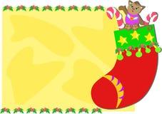 Marco de la Navidad con la media y el gato Imagen de archivo libre de regalías