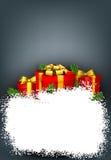 Marco de la nieve con las cajas de regalo rojas Imagen de archivo