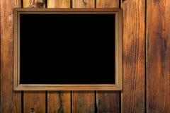 Marco de la vendimia en la pared de madera Imágenes de archivo libres de regalías