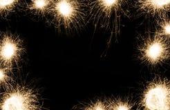 Marco de las bengalas del partido del Año Nuevo en fondo negro Foto de archivo