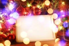 Marco de las luces de la Navidad fotos de archivo