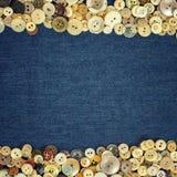 Marco de los botones del vintage en un fondo de la textura de la tela del dril de algodón fotos de archivo libres de regalías