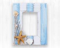 Marco de madera adornado con estilo del océano Imagen de archivo libre de regalías