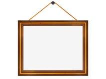Marco de madera colgado de un clavo imagen de archivo libre de regalías