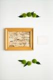 Marco de madera con el collage de la corteza y del papel de abedul Imagen de archivo