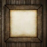 Marco de madera con el terraplén de papel Foto de archivo libre de regalías