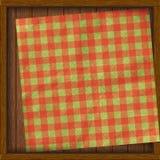 Marco de madera con la servilleta de los tableros Fotografía de archivo libre de regalías