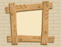 Marco de madera contra un contexto del brickwall Imagen de archivo libre de regalías