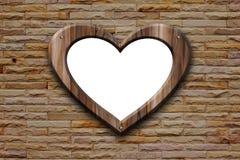 Marco de madera de la dimensión de una variable del corazón Imagenes de archivo