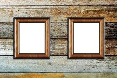 Marco de madera de la foto en el fondo de madera Imagen de archivo libre de regalías