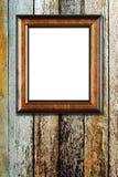 Marco de madera de la foto en el fondo de madera Imagenes de archivo