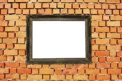 Marco de madera en la pared de ladrillo Fotografía de archivo libre de regalías