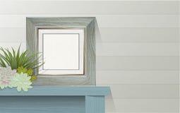 Marco de madera de la lona en blanco en la tabla Imagenes de archivo