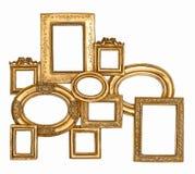 Marco de oro aislado en el fondo blanco Fotografía de archivo