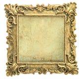 Marco de oro antiguo con la lona en el fondo blanco Foto de archivo libre de regalías