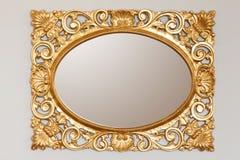 Marco de oro del espejo Imágenes de archivo libres de regalías