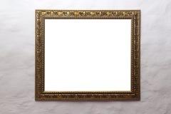Marco de oro en la pared blanca Imagen de archivo