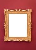 Marco de oro vacío en la pared Foto de archivo libre de regalías