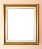 Marco de oro vacío en la pared Imagenes de archivo