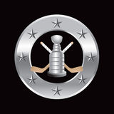 Marco de plata de la estrella con los palillos de hockey y el trofeo Imagenes de archivo