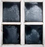 Marco de ventana con el vidrio congelado Foto de archivo