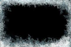 Marco decorativo de los cristales de hielo en fondo mate negro imagen de archivo