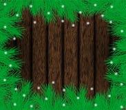 Marco del abeto de la Navidad en la madera con nieve Foto de archivo libre de regalías