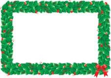 Marco del acebo de la Navidad Fotos de archivo