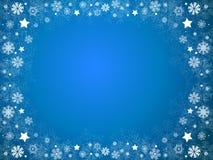Marco del azul de la Navidad de los copos de nieve y de las estrellas Imágenes de archivo libres de regalías