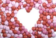 Marco del corazón del caramelo de la tarjeta del día de San Valentín Fotografía de archivo