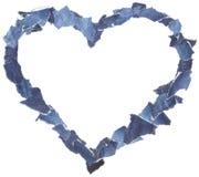 Marco del corazón hecho de pedazos de los pantalones vaqueros del dril de algodón Fotografía de archivo libre de regalías