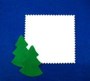 Marco del fieltro con árboles de navidad Fotografía de archivo